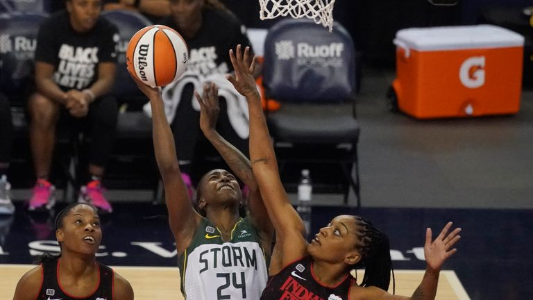 Seattle Storm's Jewell Loyd shoots against Indiana Fever's Victoria Vivians during the first half of a WNBA basketball game Thursday, June 17, 2021, in Indianapolis. (AP Photo/Darron Cummings)