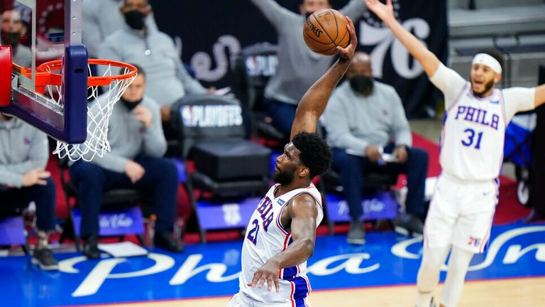 Philadelphia 76ers' Joel Embiid goes up for a dunk during the first half of Game 7 in a second-round NBA basketball playoff series against the Atlanta Hawks, Sunday, June 20, 2021, in Philadelphia. (AP Photo/Matt Slocum)