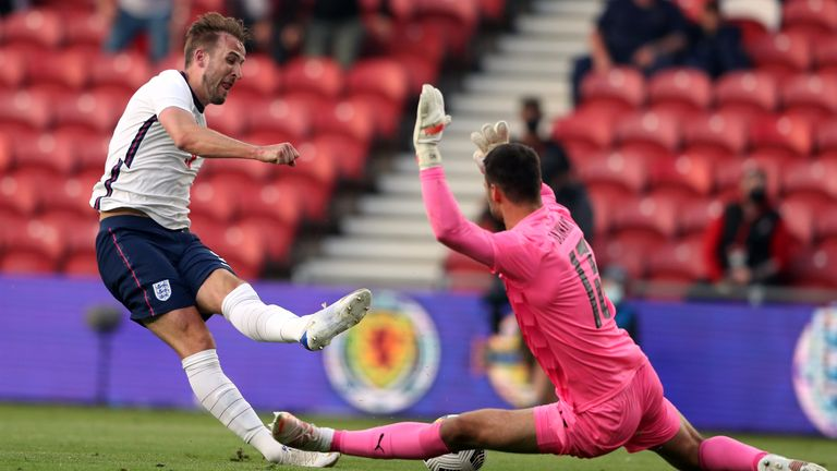 Harry Kane is denied by Austria goalkeeper Daniel Buchmann