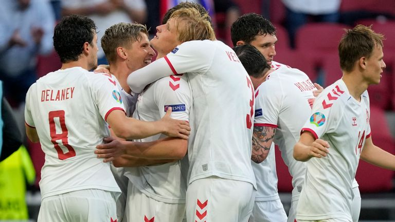 Denmark's Kasper Dolberg celebrates with team-mates after scoring his sides second goal during the Euro 2020 soccer championship round of 16 match between Wales and Denmark