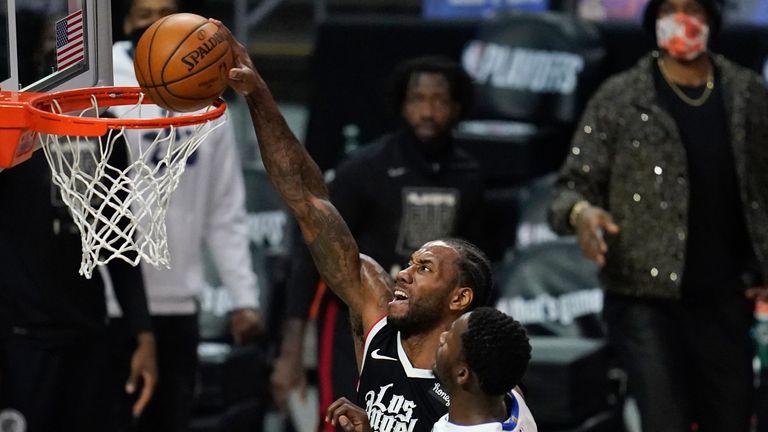 Los Angeles Clippers forward Kawhi Leonard dunks the ball against Dallas Mavericks forward Dorian Finney-Smith during Game 7 of an NBA basketball first-round playoff series