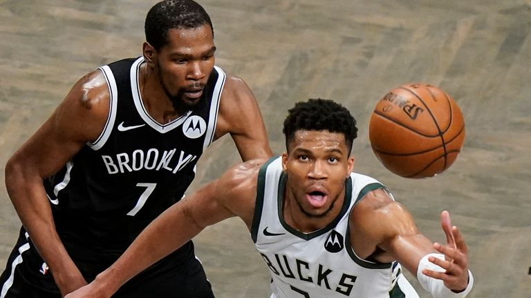 Brooklyn Nets' Kevin Durant (7) defends Milwaukee Bucks' Giannis Antetokounmpo (34) during overtime of Game 7 of a second-round NBA basketball playoff series Saturday, June 19, 2021, in New York. The Bucks won 115-111. (AP Photo/Frank Franklin II)