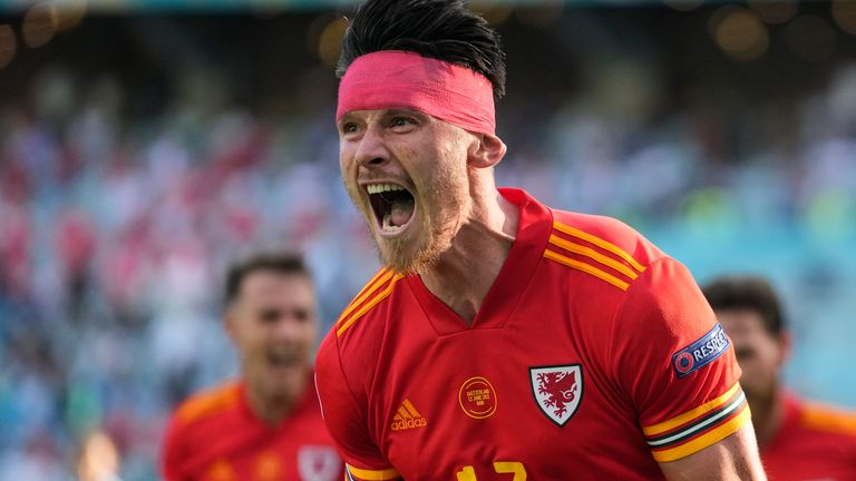 Kieffer Moore celebrates his equalising goal for Wales against Switzerland