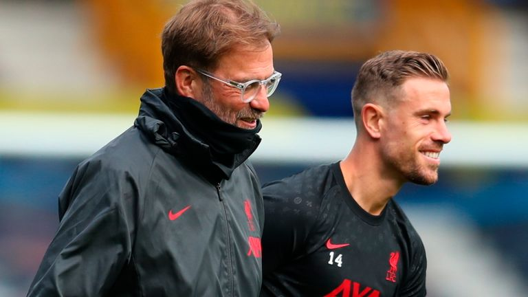 Liverpool's manager Jurgen Klopp, left, and Liverpool's Jordan Henderson walk together before the English Premier League soccer match between Everton and Liverpool at Goodison Park stadium, in Liverpool, England, Saturday, Oct. 17, 2020. (Cath Ivill/Pool via AP)