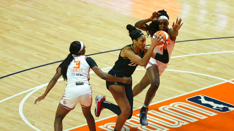 forward A'ja Wilson (22) drives to the basket against Connecticut Sun guard/forward Kaila Charles (3) and Connecticut Sun forward Beatrice Mompremier (1) during a WNBA game between Las Vegas Aces and Connecticut Sun on June 1, 2021, at Mohegan Sun Arena in Uncasville, CT. (Photo by M. Anthony Nesmith/Icon Sportswire) (Icon Sportswire via AP Images)