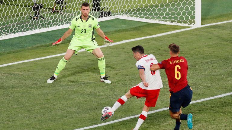 Poland's Robert Lewandowski sees a great chance saved against Spain