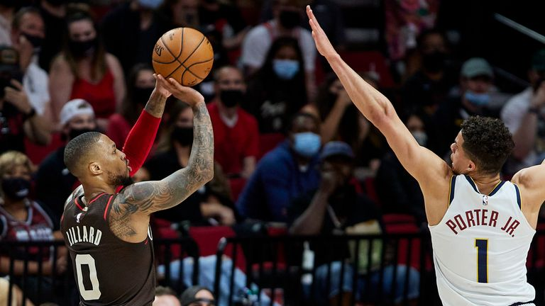 Portland Trail Blazers guard Damian Lillard shoots a 3-point basket over Denver Nuggets forward Michael Porter Jr. during Game 6 of an NBA basketball first-round playoff series