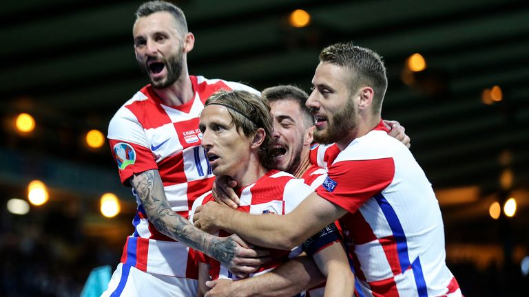 Croatia's Luka Modric is celebrated after scoring his side's second goal during the Euro 2020 soccer championship group D match between Croatia and Scotland at the Hampden Park