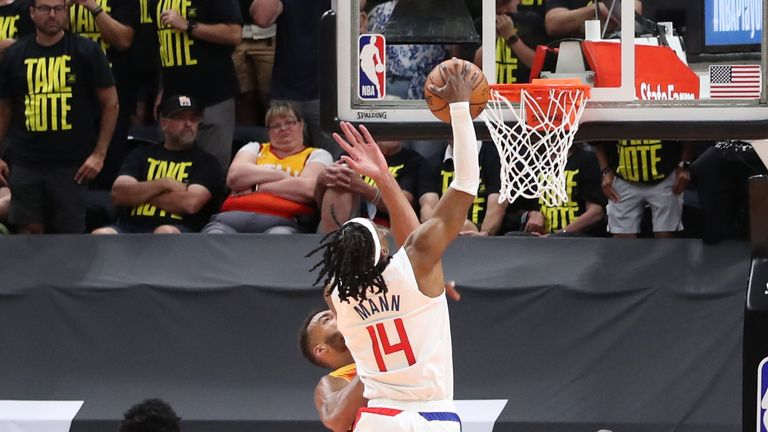 Terance Mann #14 of the LA Clippers dunks the ball during the game against the Utah Jazz during Round 2, Game 5 of the 2021 NBA Playoffs on June 16, 2021 at vivint.SmartHome Arena in Salt Lake City, Utah.