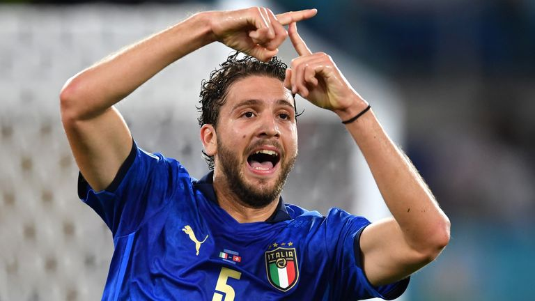 Manuel Locatelli celebrates after opening the scoring for Italy