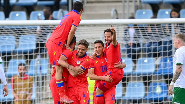 Marc Vales of Andorra celebrates with team-mates after scoring
