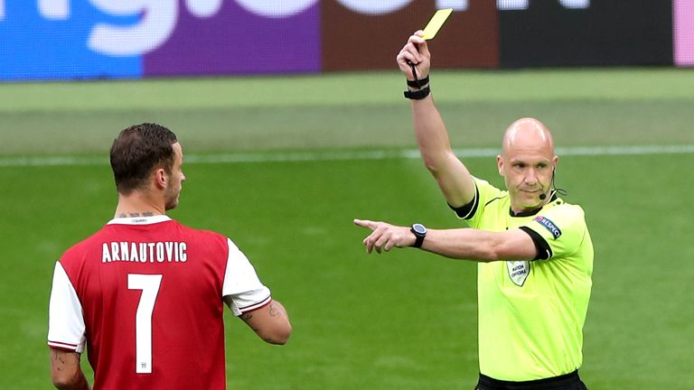 Referee Anthony Taylor shows a yellow card to Austria's Marko Arnautovic during the UEFA Euro 2020 round of 16 match against Italy