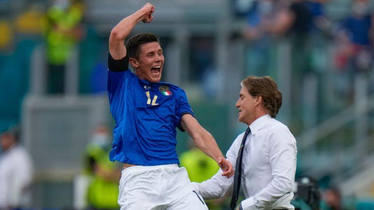 Matteo Pessina celebrates past coach Roberto Mancini after scoring against Wales