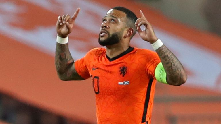 Netherlands' Memphis Depay, celebrates after scoring his side's second goal during the international friendly soccer match between the Netherlands and Scotland at the Algarve stadium outside Faro, Portugal, Wednesday June 2, 2021. (AP Photo/Miguel Morenatti)