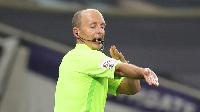 Mike Dean rules out a goal following a accidental handball in a Premier League fixture between Tottenham and Man City