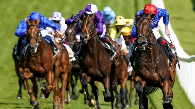 Mojo Star, in Amo Racing's purple colours, chases home Derby winner Adayar