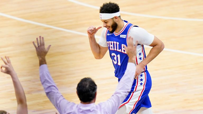 Philadelphia 76ers' Seth Curry, right, reacts after making a three-pointer during the second half of Game 5 in a second-round NBA basketball playoff series against the Atlanta Hawks, Wednesday, June 16, 2021, in Philadelphia.