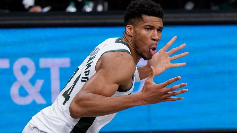 Milwaukee Bucks forward Giannis Antetokounmpo (34) reacts after dunking, next to Brooklyn Nets forward Blake Griffin (2) during the first half of Game 5 of a second-round NBA basketball playoff series Tuesday, June 15, 2021, in New York.