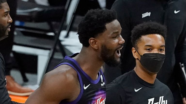 Phoenix Suns center Deandre Ayton, middle left, celebrates after the Suns defeated the Los Angeles Clippers in Game 2 of the NBA basketball Western Conference Finals, Tuesday, June 22, 2021, in Phoenix.