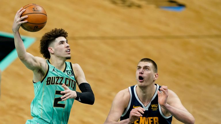 Charlotte Hornets guard LaMelo Ball shoots over Denver Nuggets center Nikola Jokic during the second half of an NBA basketball game on Tuesday, May 11, 2021, in Charlotte, N.C.