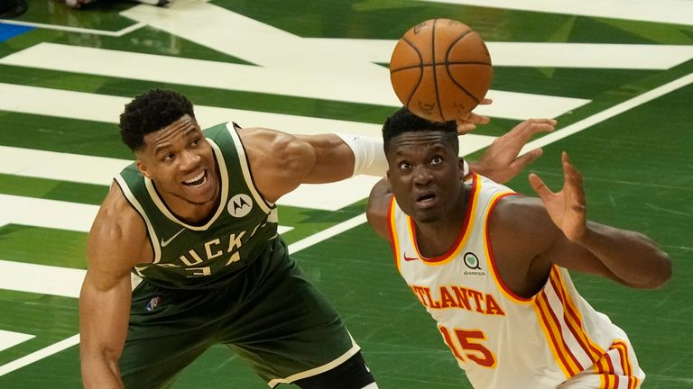 Atlanta Hawks' Clint Capela and Milwaukee Bucks' Giannis Antetokounmpo go after a loose ball during the second half of Game 1 of the NBA Eastern Conference basketball finals game Wednesday, June 23, 2021, in Milwaukee. (AP Photo/Morry Gash)