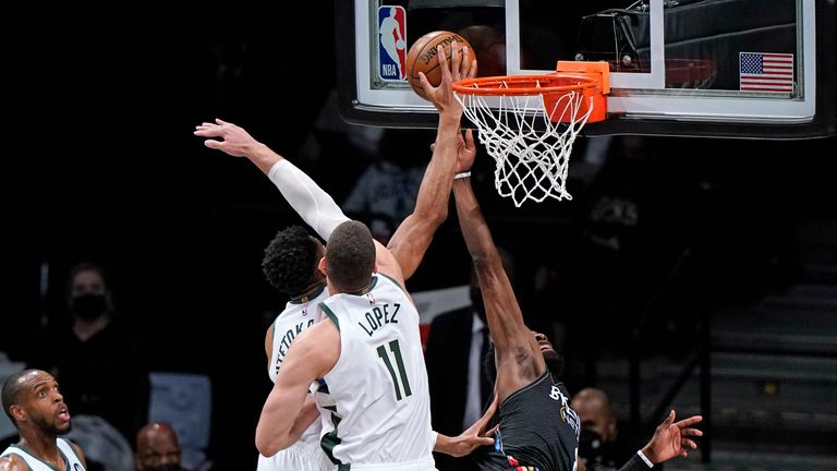 Milwaukee Bucks forward Giannis Antetokounmpo (34) blocks a shot by Brooklyn Nets forward Jeff Green (8) as Milwaukee Bucks forward Khris Middleton (22) and Bucks guard Pat Connaughton (24) look on from the floor in Game 5 of a second-round NBA basketball playoff series, Tuesday, June 15, 2021, in New York. Bucks center Brook Lopez (11) gets in on the defense.