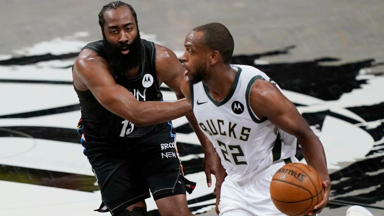 Brooklyn Nets guard James Harden (13) defends Milwaukee Bucks forward Khris Middleton (22) as Middleton drives to the basket during the first half of Game 5 of a second-round NBA basketball playoff series, Tuesday, June 15, 2021, in New York.