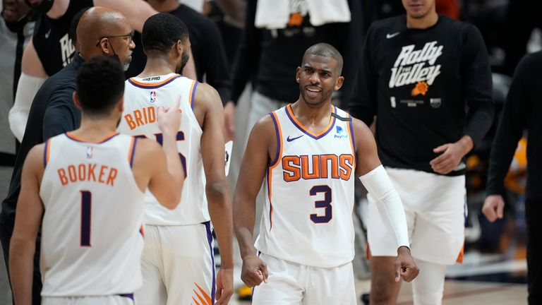 Phoenix Suns guard Chris Paul congratulates teammates during a time out in the second half of Game 4 of an NBA second-round playoff series against the Denver Nuggets Sunday, June 13, 2021, in Denver.  (AP Photo/David Zalubowski)...................