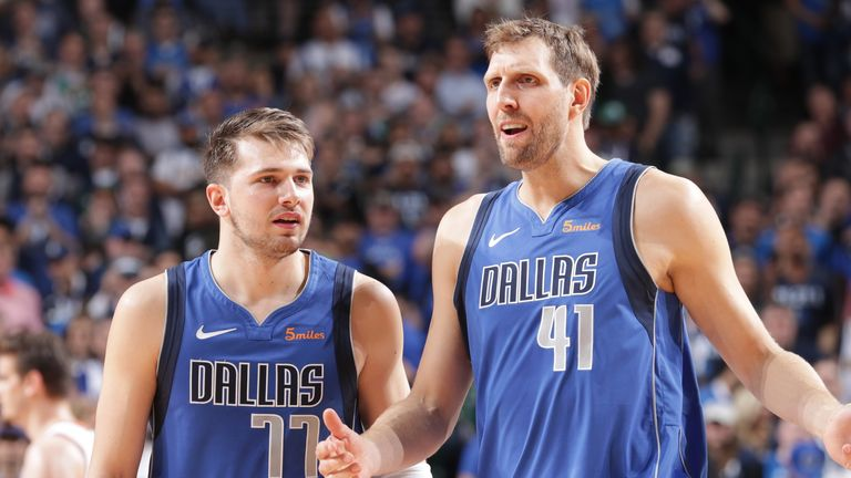 Luka Doncic and Dirk Nowitzki of the Dallas Mavericks talk during a game against the Phoenix Suns in 2019