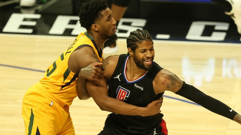 Donovan Mitchell and Paul George tussle for the ball during Game 4