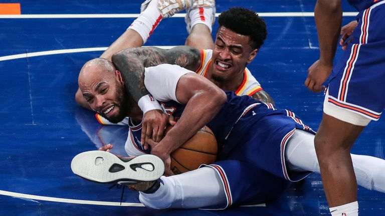 New York Knicks center Taj Gibson, left, and Atlanta Hawks forward John Collins (20) fight for a loose ball during the third quarter of Game 5 of an NBA basketball first-round playoff series Wednesday, June 2, 2021, in New York.