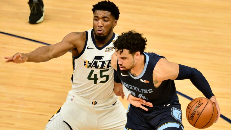 Memphis Grizzlies forward Dillon Brooks (24) handles the ball against Utah Jazz guard Donovan Mitchell (45) in the first half of Game 4 of an NBA basketball first-round playoff series Monday, May 31, 2021, in Memphis, Tenn.