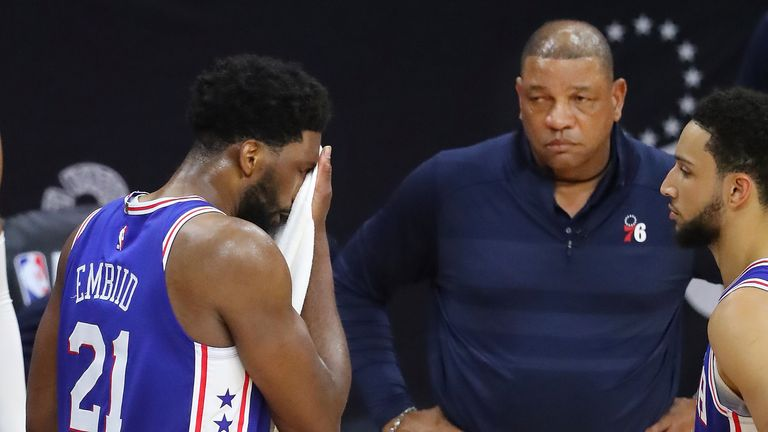 Philadelphia center Joel Embiid reacts with head coach Doc Rivers looking on during the final seconds of the 76ers' Game 5 defeat