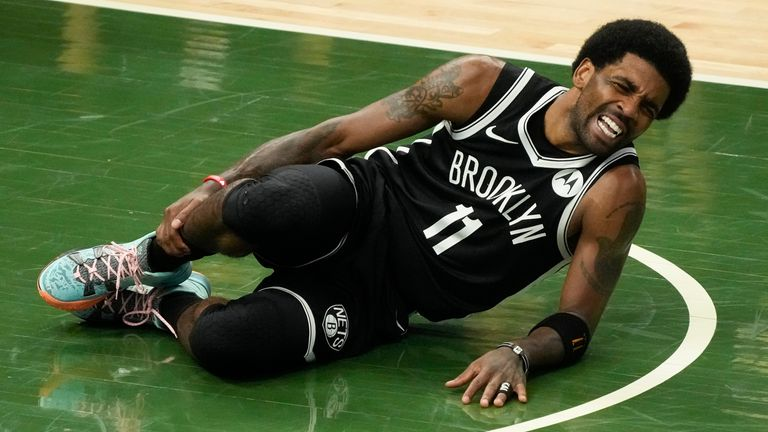 Brooklyn Nets' Kyrie Irving goes down with an injury during the first half of Game 4 of the NBA Eastern Conference basketball semi-finals game against the Milwaukee Buck