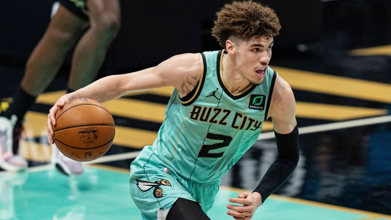Charlotte Hornets guard LaMelo Ball (2) brings the ball up court against the Los Angeles Clippers during an NBA basketball game in Charlotte, N.C., Thursday, May 13, 2021. (AP Photo/Jacob Kupferman)