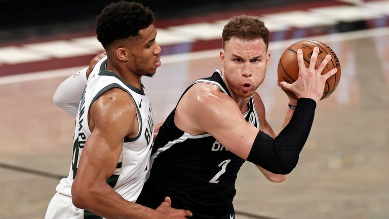 Brooklyn Nets forward Blake Griffin (2) looks to pass around Milwaukee Bucks forward Giannis Antetokounmpo (34) during the second half of Game 1 of an NBA basketball second-round playoff series Saturday, June 5, 2021, in New York.