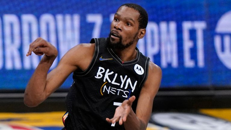 Brooklyn Nets forward Kevin Durant (7) watches as he sinks a 3-point shot during the fourth quarter of Game 5 of a second-round NBA basketball playoff series against the Milwaukee Bucks, Tuesday, June 15, 2021, in New York.