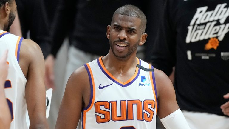 Phoenix Suns guard Chris Paul congratulates teammates during a timeout in the second half of Game 4 of an NBA second-round playoff series against the Denver Nuggets, Sunday, June 13, 2021, in Denver.