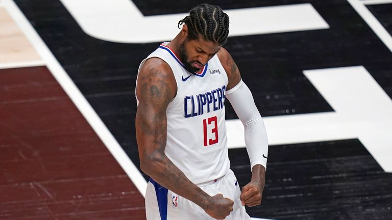 Los Angeles Clippers guard Paul George (13) flexes his muscles after scoring against the Utah Jazz during the first half of Game 5 of a second-round NBA basketball playoff series Wednesday, June 16, 2021, in Salt Lake City. (AP Photo/Rick Bowmer)