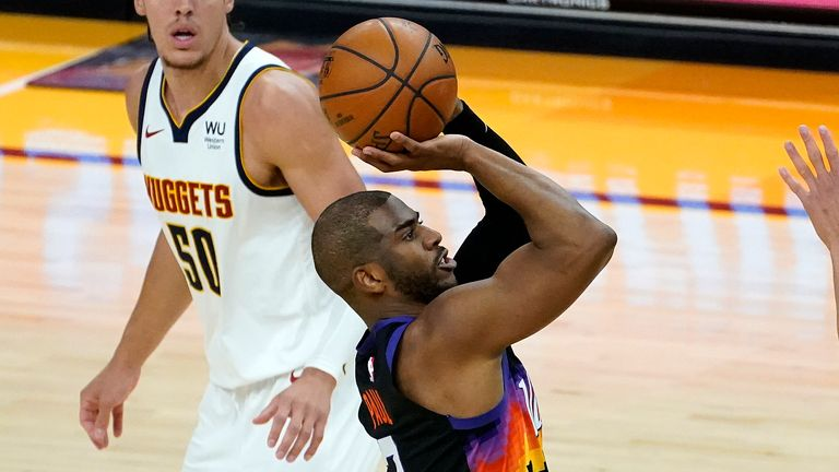 Phoenix Suns guard Chris Paul (3) shoots as Denver Nuggets forward Aaron Gordon (50) looks on during the second half of Game 1 of an NBA basketball second-round playoff series, Monday, June 7, 2021, in Phoenix.