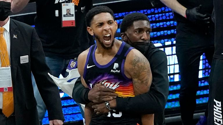 Phoenix Suns' Cameron Payne, center left, celebrates with teammates during the second half of Game 2 of the NBA basketball Western Conference Finals against the Los Angeles Clippers, Tuesday, June 22, 2021, in Phoenix.