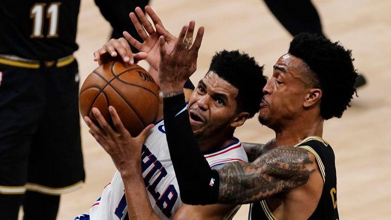 Philadelphia 76ers forward Tobias Harris (12) drives against Atlanta Hawks forward John Collins (20) during the first half of their NBA playoff game Friday, June 18, 2021, in Atlanta. (AP Photo/John Bazemore)