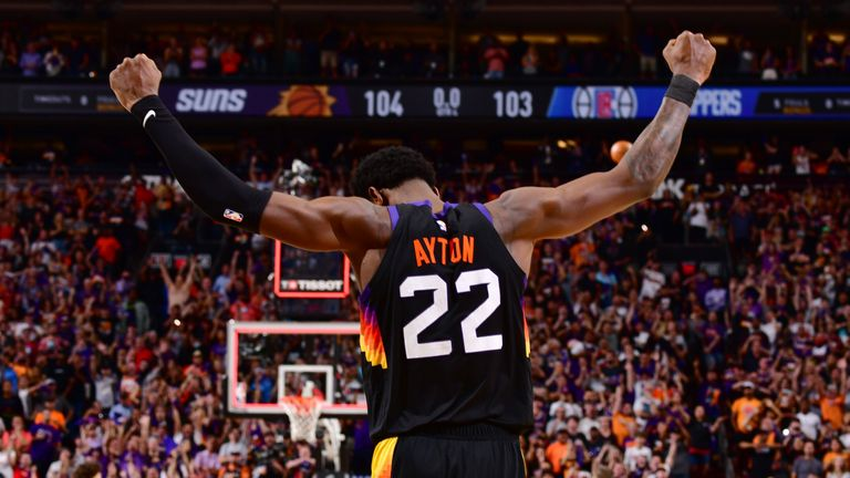 PHOENIX, AZ - JUNE 22: Deandre Ayton #22 of the Phoenix Suns celebrates after the game against the LA Clippers during Game 2 of the Western Conference Finals of the 2021 NBA Playoffs on June 22, 2021 at Phoenix Suns Arena in Phoenix, Arizona. NOTE TO USER: User expressly acknowledges and agrees that, by downloading and or using this photograph, user is consenting to the terms and conditions of the Getty Images License Agreement. Mandatory Copyright Notice: Copyright 2021 NBAE (Photo by Barry Gossage/NBAE via Getty Images)