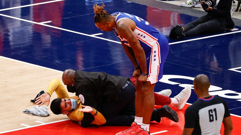 Philadelphia 76ers' center Dwight Howard looks down at a fan who ran onto the court and was tackled by security in Game Four of the Eastern Conference first round series against the Washington Wizards