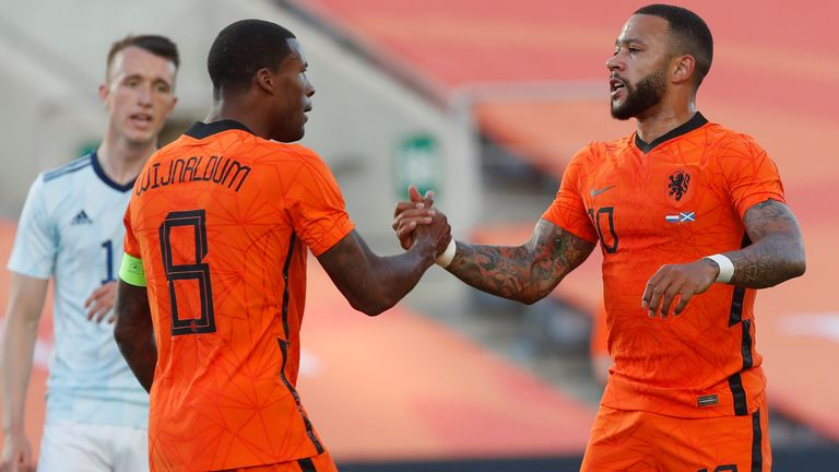Netherlands' Memphis Depay, right, celebrates with Netherlands' Georginio Wijnaldum after scoring his side's first goal during the international friendly soccer match between the Netherlands and Scotland at the Algarve stadium outside Faro, Portugal, Wednesday June 2, 2021. (AP Photo/Miguel Morenatti)