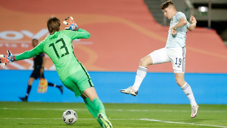 Scotland's Kevin Nisbet scores his side's second goal past Netherlands' goalkeeper Tim Krul during the international friendly soccer match between the Netherlands and Scotland at the Algarve stadium outside Faro, Portugal, Wednesday June 2, 2021. (AP Photo/Miguel Morenatti)