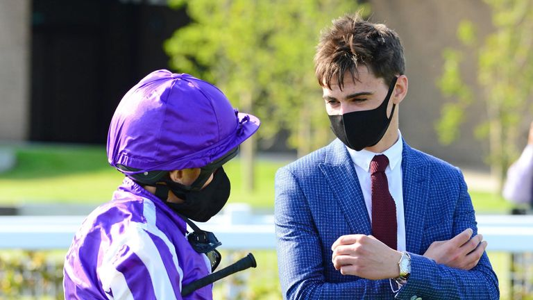 O'Brien talks with jockey Ryan Moore after victory in the Moyglare Stud Stakes
