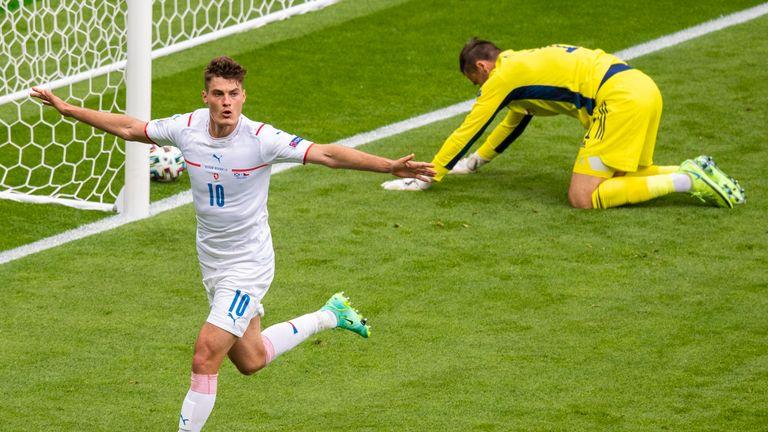 Czech Republic's Patrik Schick celebrates after he rises above Grant Hanley to head home to make it 1-0