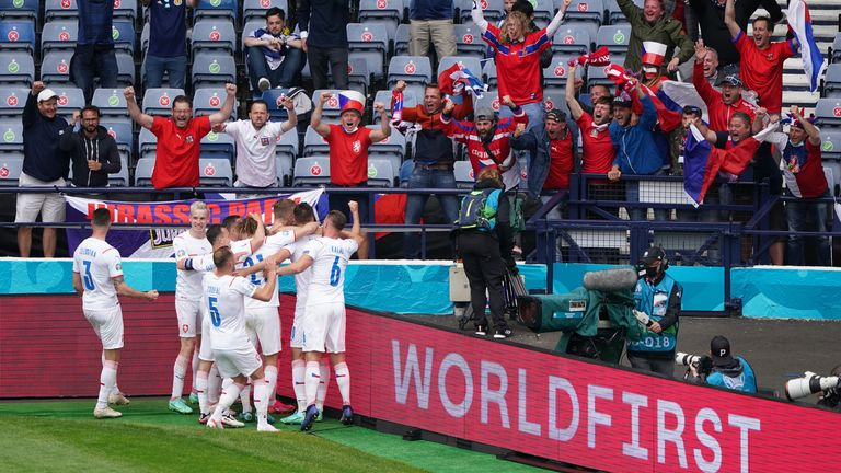 Patrik Schick and his teammates celebrate in front of Czech supporters after scoring their second goal of the game
