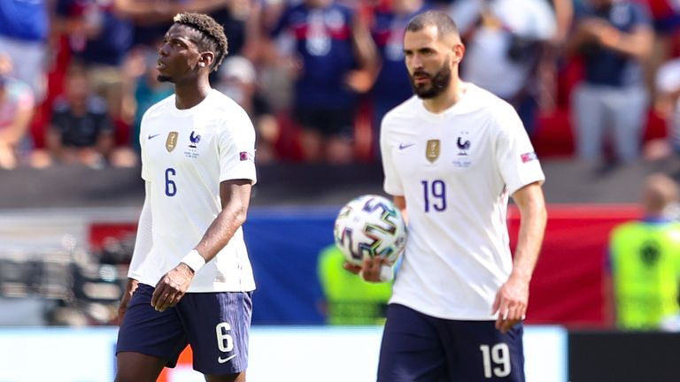 Paul Pogba and Karim Benzema react after Hungary's goal